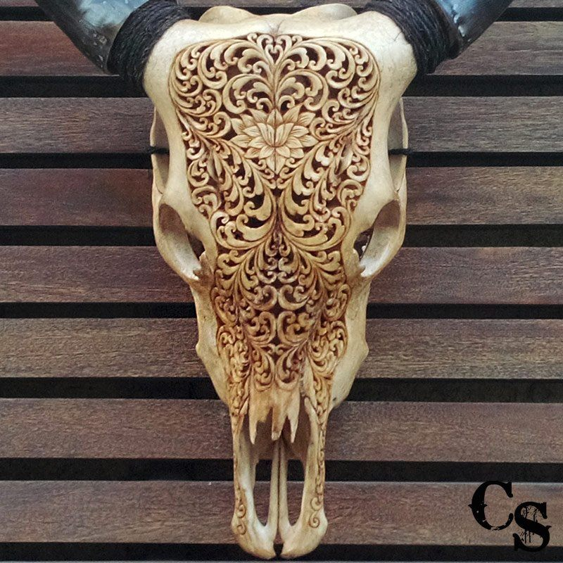 Cow Skull With Lotus Heart Design In A Brown Color Carved Skulls