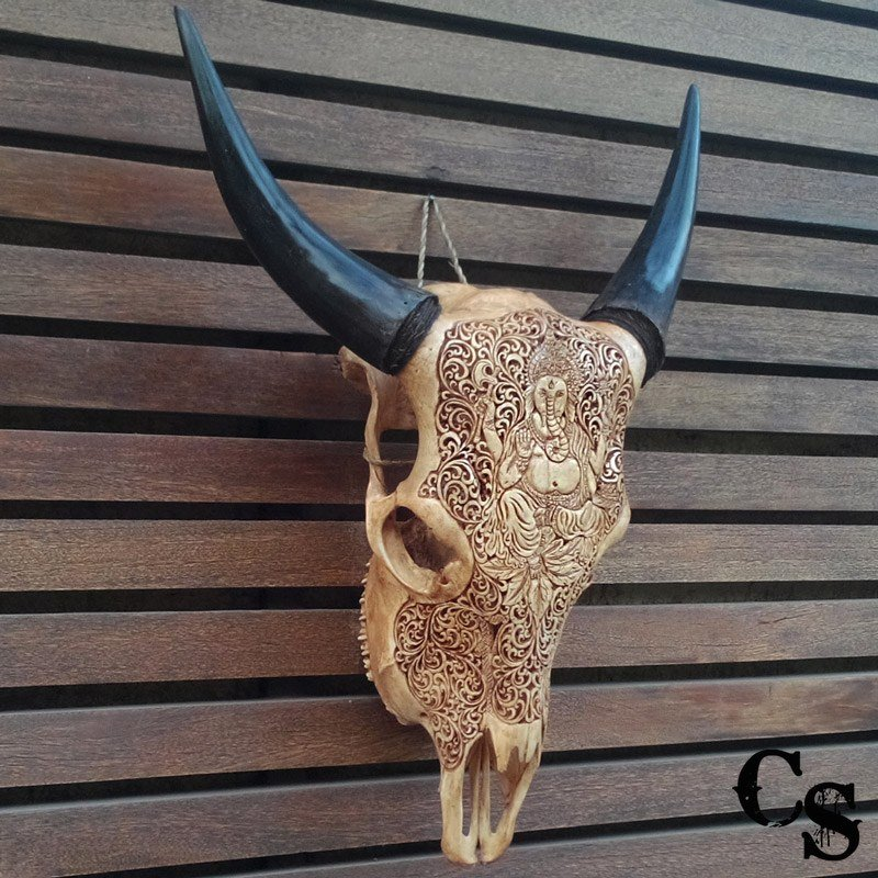 Hand carved bull cow skull with ganesha design antique