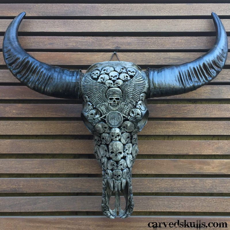 Carved buffalo skull with biker design grey