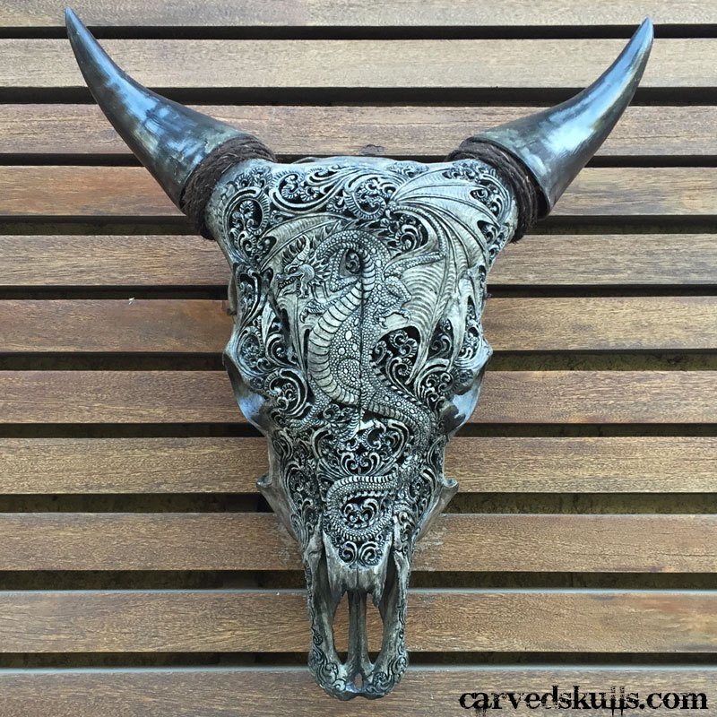 Hand carved bull cow skull with dragon design